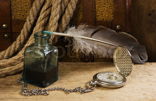 old pocket watch and inkwell, still life