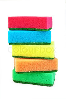 A stack of red, blue, yellow, orange and green sponges isolated on white background