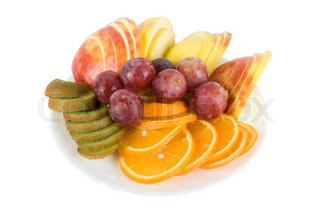 Colorful fruit salad with orange, kiwi, grapes and apple