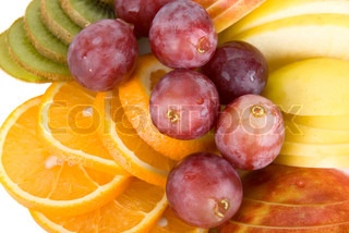 Healthy fresh fruits background with orange, kiwi, grapes and apple