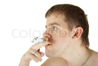 young man with many cigarettes in his mouth