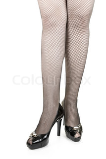 Long beauty woman legs with black stokings isolated on white