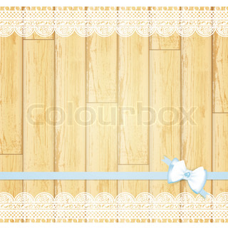 lace frame with bow at light wooden background