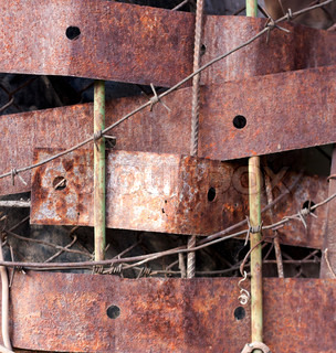 Rusty Metal background. Ripped corrosion wall