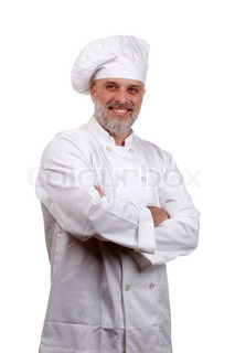 Portrait of a happy chef in a chef's hat and uniform isolated on a white background.
