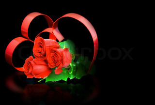 St. Valentine Day. Couple of hearts, on black background with red roses.