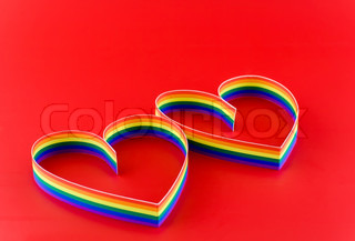 Two hearts, paint of a six-colour gay flag.