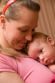 Happy maternity: mother with her baby boy