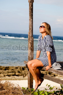 Young adult woman relaxing on the beachfront