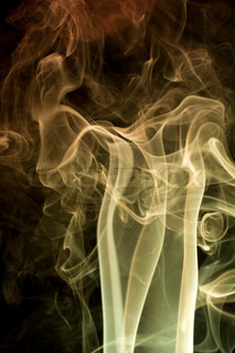 Smoke on black background with nice fancy wave patterns. Useful for abstract backgrounds