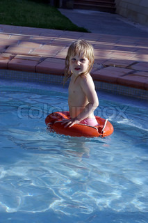 Small child flies alone in the pool