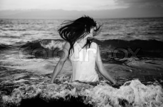 Woman in the cold water of the sea