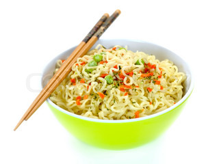 Cooked instant noodles isolated against a white background