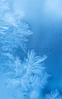 Fairy-like sparkling winter background (slightly blurred frostwork on a window glass)