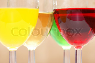 Three colour liquers isolated on the white - look for other similar photos in my portfolio