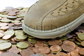 light brown leather shoe walking on euro coins