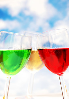 Cocktails of various colors  against blue sky