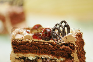 Close up of cake slice  with chocolate topping