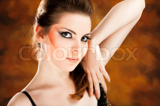 Fashion photo of beautiful nude woman on colored background