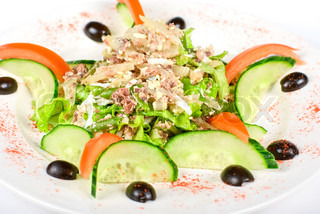 Salad of tuna fish with string beans, eggs, lettuce, boiled potato and fresh cucumbers and tomato
