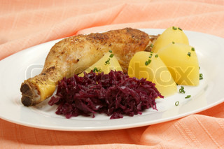Grilled chicken drumstick with potatoes and red cabbage