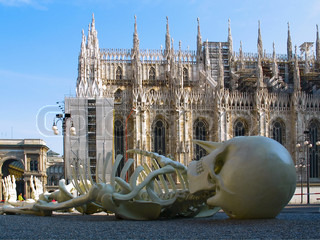 Cathedral Duomo  in Milan  at   left wing of Cathedral.  In front view a skeleton. Italy
