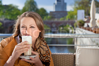 attractive young woman relaxing in street cafe