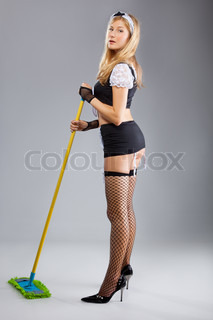 The sexy cleaner, isolated  on a grey background