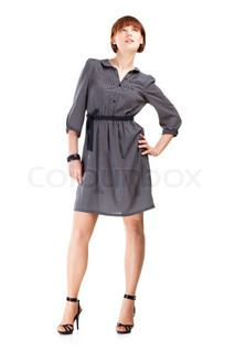 Full length portrait of a confident young female standing on white background