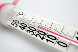 Closeup of celsius thermometer showing heat readings. Isolated against a white background. Small Depth of field. Focus on mark 30