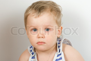 cute sad one year old boy studio portrait