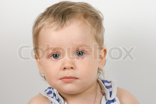 cute one year old boy studio portrait