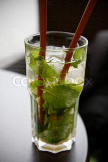 Nice cold Mojito long drink on cafe table at summertime.