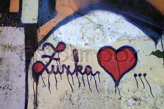 Detail of Slovakian graffiti  about love on old wooden wall.