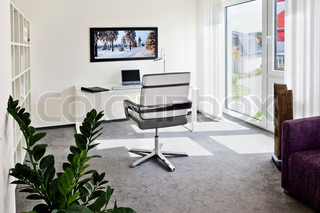 Modern interior of home office with writing table