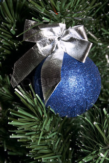 Blue christmas ball with silver ribbon