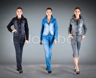 girl in jeans collection clothes on a dark background