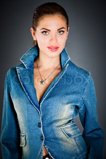beautiful girl in a jeans jacket on the dark