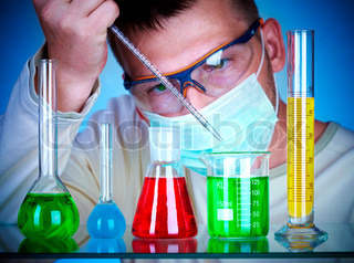 Young scientist in laboratory with test tubes