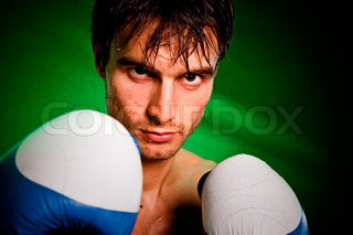 Man sweating all over in boxing gloves...