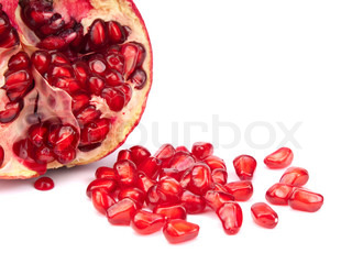 Half of pomegranate with seeds on white background