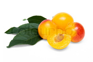 three yellow cherry plums and a half cherry plum on a white background