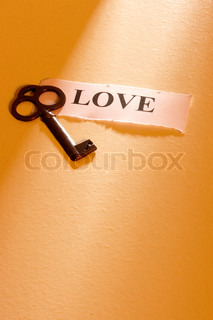 A key laying on a piece of paper with the word