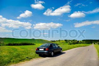 Car is parked in road side with beautiful landscape