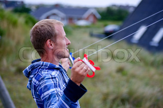 Man flying a kite in the nature