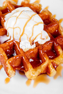 Tasty waffle and ice cream with cream