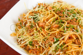 Pasta with meat and greens closeup tasty dish
