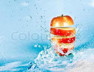 fresh water splash on red apple