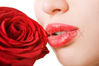 Close-up of beautiful girl with red rose