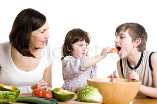 Mother and children cooking salad at the kitchen stock - Bambine che cucinano ...